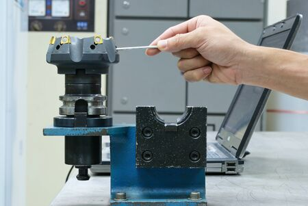 Try to lock insert of face milling tool Stock Photo