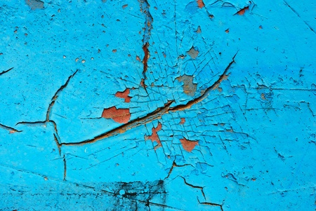 Big crack on the old blue truck abstract background