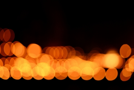 Bokeh of the candle with dark background photo