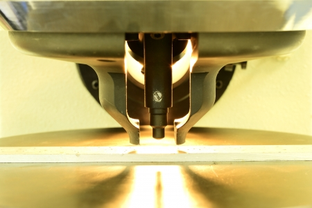 modulus: Light from hardness testing machine during calibration