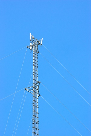 wireless tower: Telecommunication post for mobile phone with clear sky