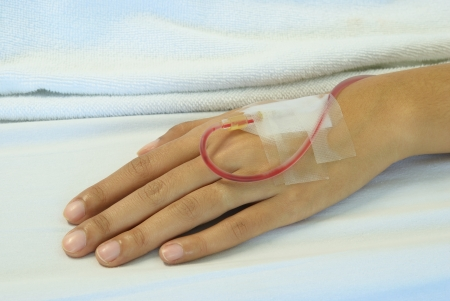 Close up of the patien hand with blood in the tube
