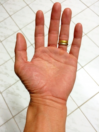 Hand of the man on tile background