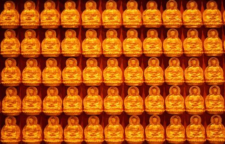 Buddha statue on the wall backgrond for Chinese new year Stock Photo