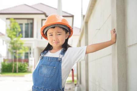 Funny action and face of little engineer before work Stock Photo
