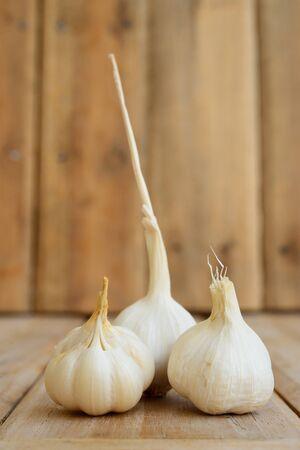 tripple: Still life shot of tripple garlic on wood  Stock Photo