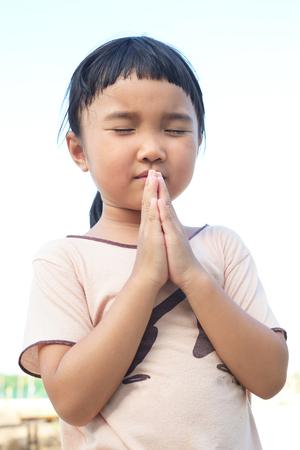 elysium: Thai girl praying and close her eye for something