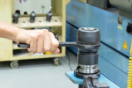 collet: Hand held special tool to remove CNC collet Stock Photo