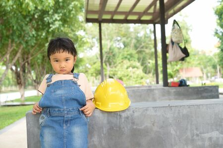 tried: Kid engineer look so tried during work in the garden building site
