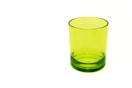 Green plastic glass on isolated white background for graphic designer Stock Photo