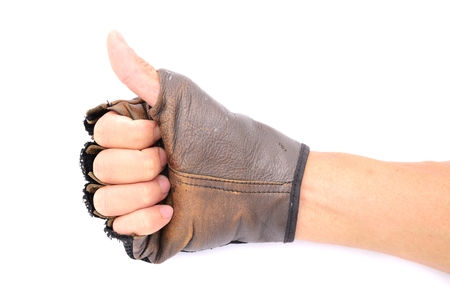Hand with leather glove thumb up on isolated white