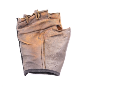 Old leather gloves on isolated white background