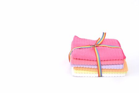 Package of towel on isolated white background photo