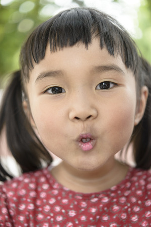 pink lips: Asian kid with cheeky mood and pink lips Stock Photo