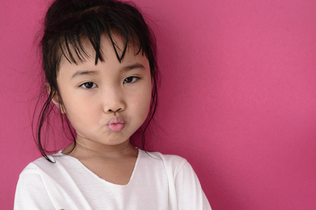 Kid with moody face while her sick mode