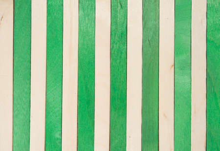 Wood vertical separated on green and original color abstract background