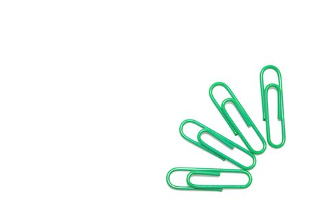 Green paper clip on isolated white for background Stock Photo