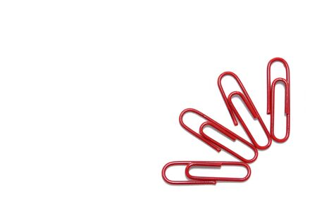 Red paper clip on isolated white for background Stock Photo