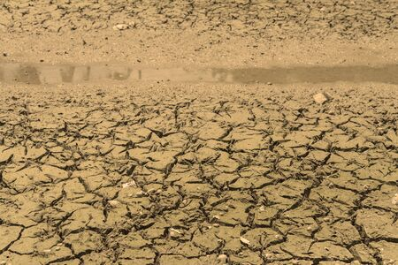 desertification: Close up to water in the canal and crack soil