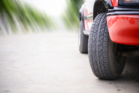 Car tire on the road with motion blur road background Stock Photo