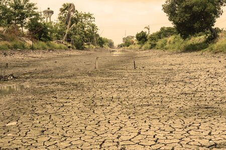 run out: run out of water in the canal and crack soil sepia tone Stock Photo