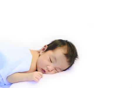 Cute baby sleeping on white cotton blanket with blank space for text