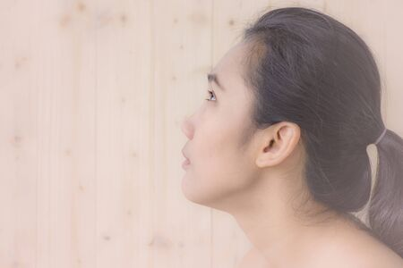 woman portrait with blur wood wall background Stock Photo
