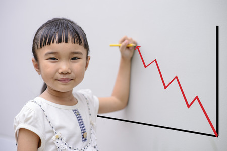 Kid write graph on grey wall with smiling face