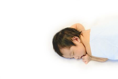 Cute baby sleeping on the white cotton blanket