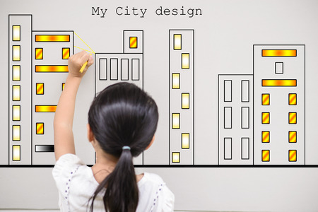 Kid Drawing city design ongrey wall