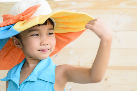 girl pose: Little girl pose with hat and blur wood background