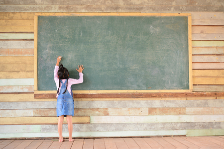 girl studying: Kid write back to school font on old green chalkboard Stock Photo