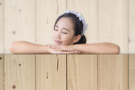 woman relax and nap with blur wood texture background Stock Photo