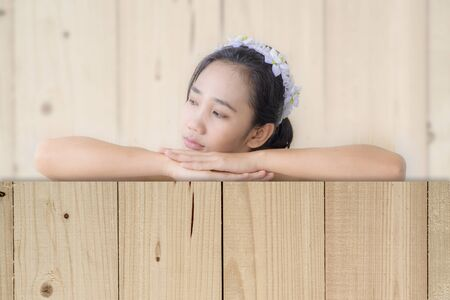 woman relax with blur wood texture background Stock Photo