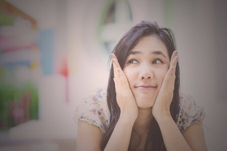 retro woman: Asian woman thinking; Vintage tone; Retro Tone Stock Photo