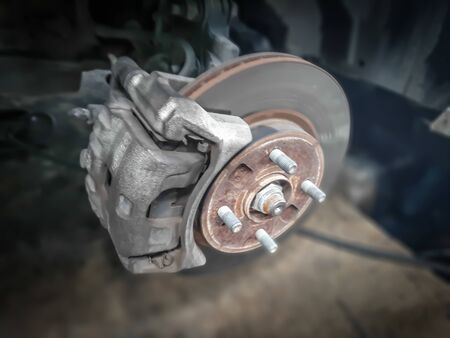 Car take wheel off show drum brake assembly. changing tire.