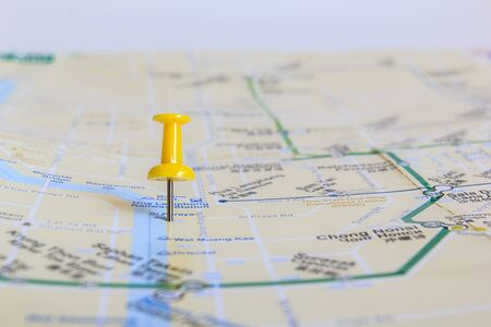yellow pushpin: ?Yellow pushpin showing the location of a destination point on a map