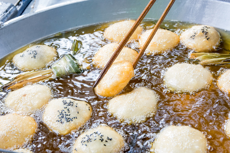 boiling: Frying  pastry with fillings in boiling oil. with iron pan Stock Photo