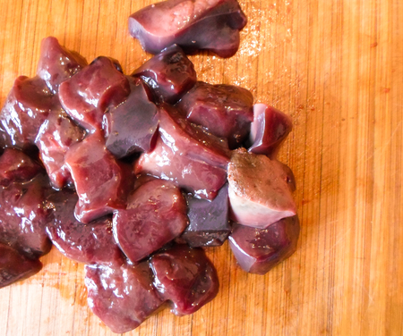 Pieces of fresh juicy liver meat on a wooden Board