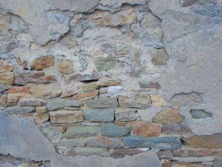 real stone wall without cement. old house with stone walls. stone wall background picture old building