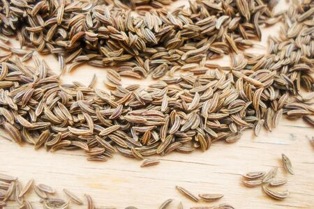 a lot of caraway seeds on a wooden table. Healthy lifestyle concept. 写真素材