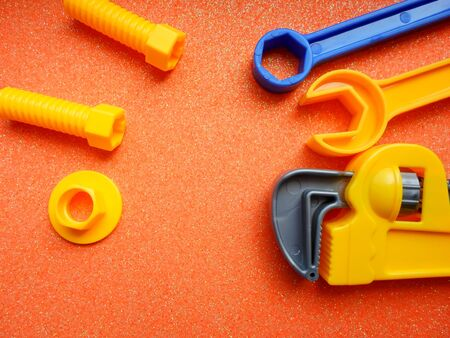 toy tools, wrench and others on an orange background. place for text Stok Fotoğraf