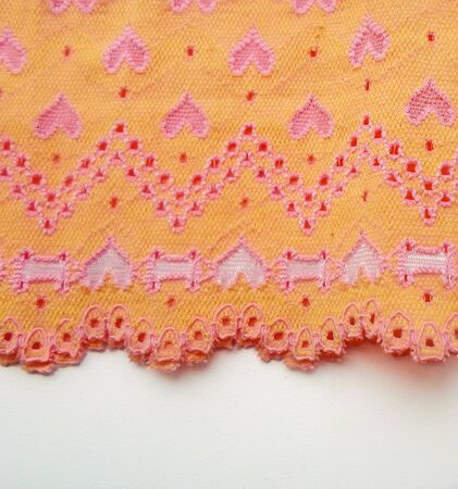 yellow fabric with hearts. Red and pink hearts on a yellow fabric 写真素材