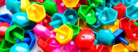 Top childrens toys on the floor. Educational colorful toys. Kids toys frame on background.