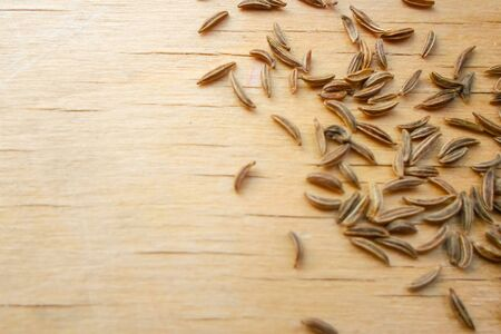a lot of caraway seeds on a wooden table. Healthy lifestyle concept. Standard-Bild