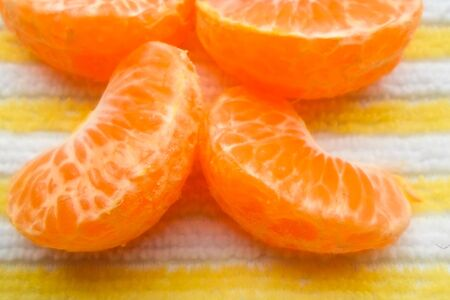 a lot of tangerine on a table with a napkin