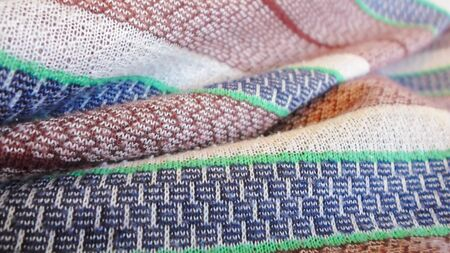 multi-colored stripe fabric for the background, white, brown, blue and blue stripes on the fabric. home textiles Фото со стока