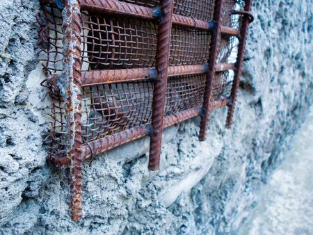 iron grate on a concrete wall. iron windows in prison 写真素材