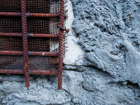 iron grate on a concrete wall. iron windows in prison 写真素材 - 130046039