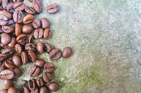 roasted coffee beans on a gray background, can be used as a background. large grains of coffee and place for text 写真素材
